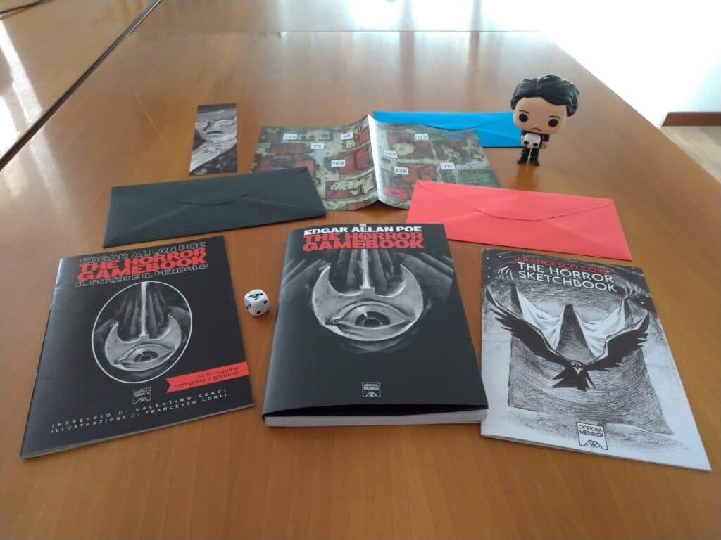 Edgar Allan Poe The Horror Gamebook, Il pozzo e il pendolo, segnalibro, tre lettere con tre capitoli extra, l'artbook. Insomma, un bel po' di materiale!